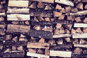 Dry Firewood neatly stacked in the woodpile. Background with a p