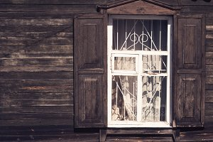 old wooden window with shutters and casings on the old wooden bo