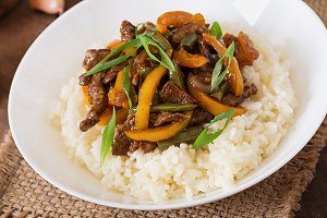 Stir frying beef with rice.