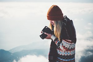 Woman photographer foggy mountains