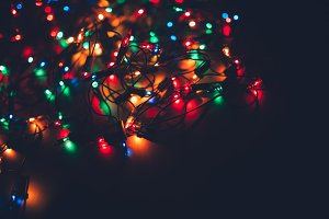 Christmas lights on dark background. Decorative garland. Tinted photo