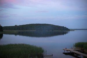 sunrise over a lake with island