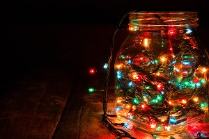 glass jar with glowing garlands