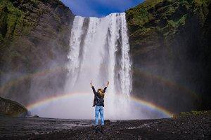 woman on waterfall