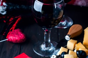 two glasses of wine with a blanket