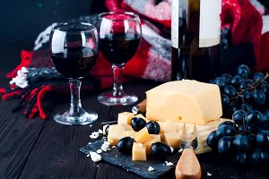 two glasses of red wine and cheese
