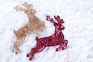 Two decorative deer red and gold colors