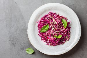 Cabbage salad with soybean sprouts and edible garlic flowers