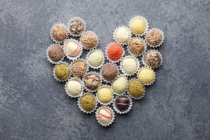 Truffle chocolates arranged in heart