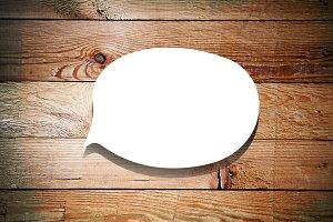 Speech bubble on wood