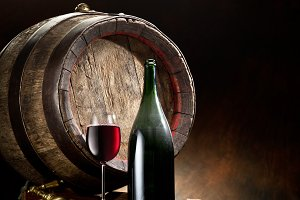 glass of wine, bottle and barrel