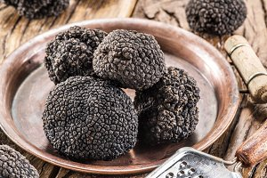 Black truffles on the plate