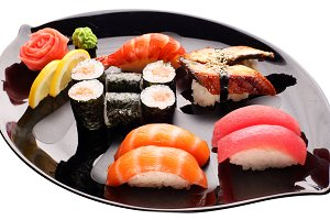 Sushi on the black plate.