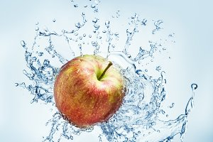 Apple fruit with water splash.