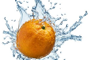 Orange fruit with water splash.