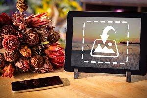 Digital tablet near bouquet