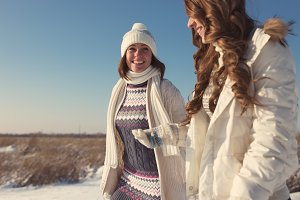 Two girls having fun at winter time