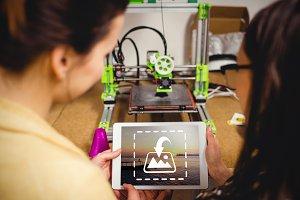 Designers looking at digital tablet