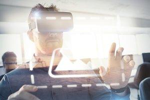 Businessman using virtual reality