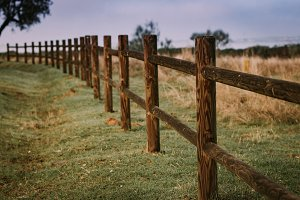 Long rustic wooden fence