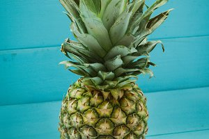 Pineapple on blue wooden table