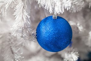 blue decoration white christmas tree