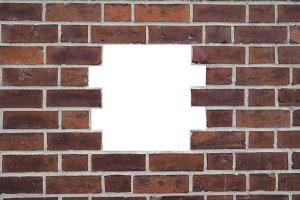 Red brick wall with hole