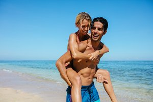 Couple enjoying piggyback ride