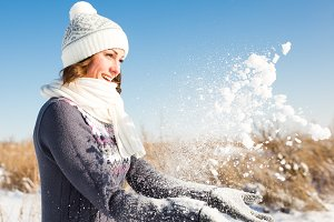 Young woman having fun at winter day
