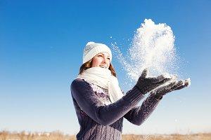 Young woman having fun at winter day