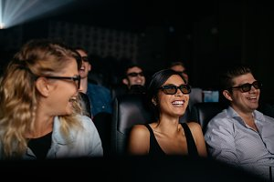 Men and women watching 3d film