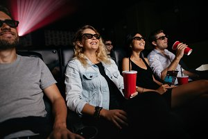 Young people watching 3d film