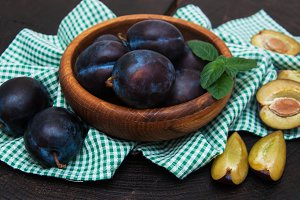 Bowl with  plums
