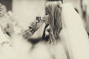 Bride kisses a crown in church