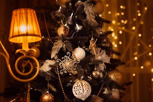 Decorated Christmas tree shined with classic sconce