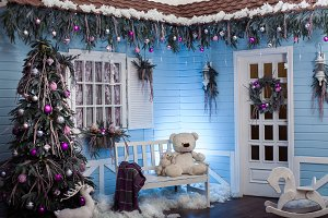 Winter exterior of a country house with Christmas decorations in the Florida style.