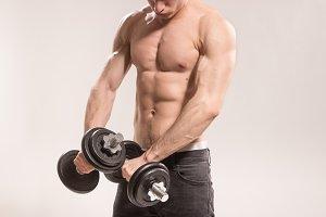 man bodybuilder upper body dumbbells