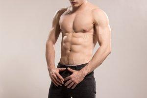 man strong muscular upper body abs