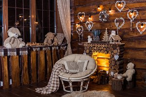 Wooden decorative fireplace, papasan chair and romantic bulbs