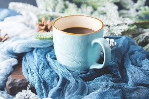 Mug of coffee and milk on dark winter background