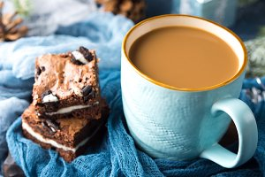 Cream cheese brownies and coffee with milk