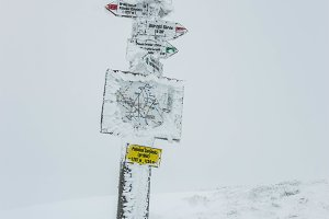 Frozen hiking signs
