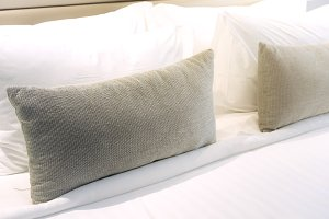 Comfortable soft pillows on the bed