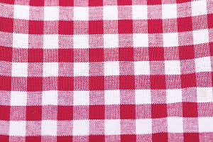 Red and white checkered fabric background