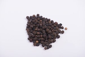 Peppercorns on white background. Isolated.