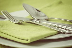 Tableware on green
