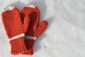 Red Winter Mittens in the Snow
