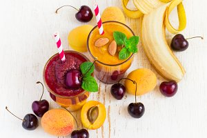 Fresh seasonal colorful Smoothies of apricot and sweet cherry