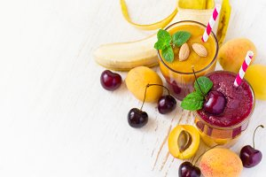 Fresh seasonal colorful Smoothies of apricot and sweet cherry. T