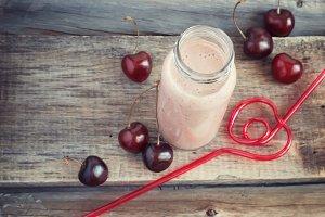 Cherry milkshake and straw
